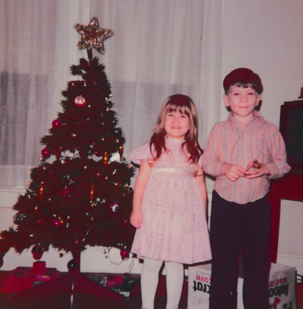 Picture of me and Lee with a Christmas tree, December 1974